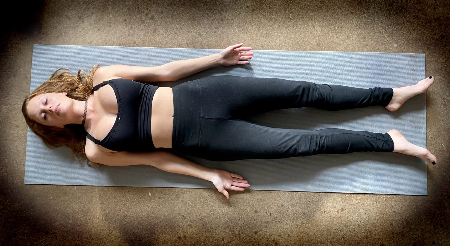 This image has an empty alt attribute; its file name is shavasana-1-1500x821.jpg